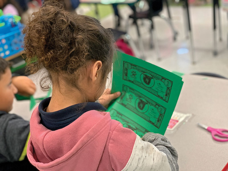 From Creating Mini-Economies to Parsing Fictional Spending Scenarios, Here's How Librarians Teach Financial Literacy to Kids